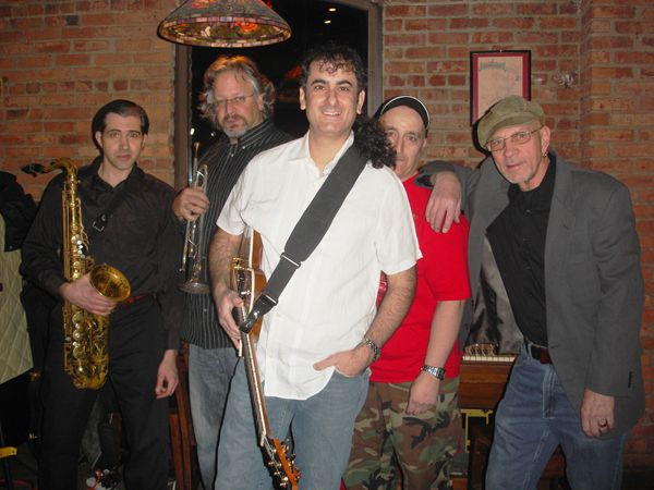 Guitarrist Andy Rothstein poses with his band