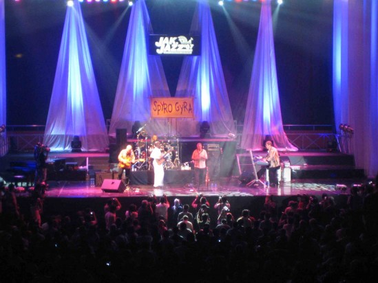 Spyro Gyra in concert, the stage awash in multi-colored lights